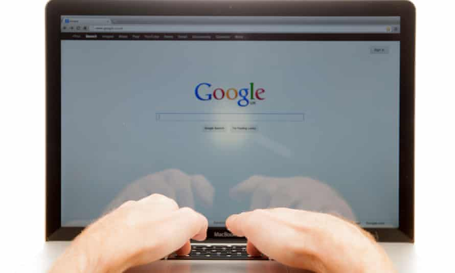 A person uses Google on a laptop