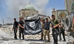 Members of the Iraqi counter-terrorism service (CTS) hold upside-down the black flag of Isis after retaking the area in June 2017.