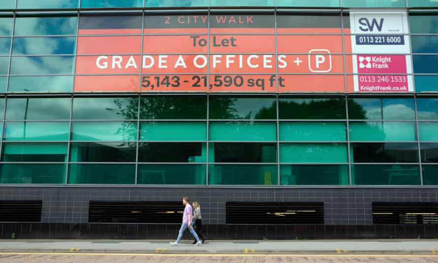 People walk past empty office space in Leeds city centre