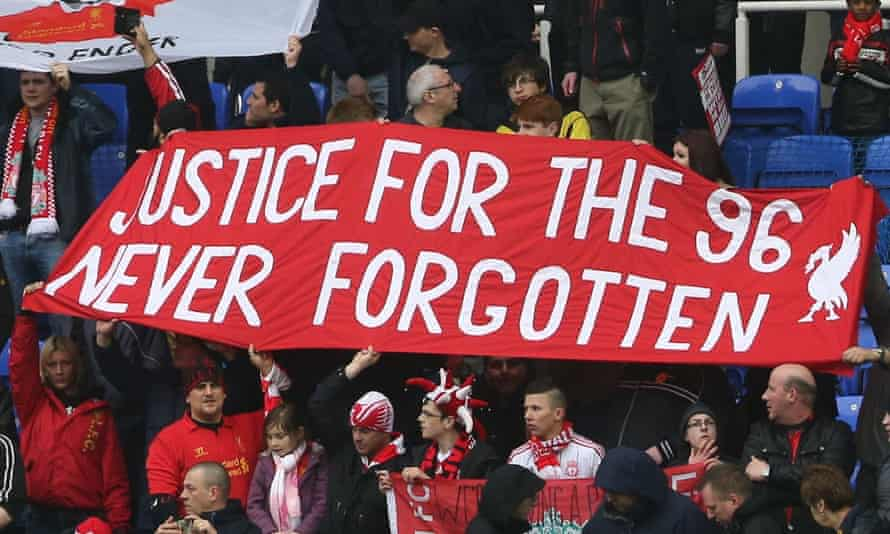 Liverpool fans hold up banners commemorating those who lost their lives in the 1989 Hillsborough disaster