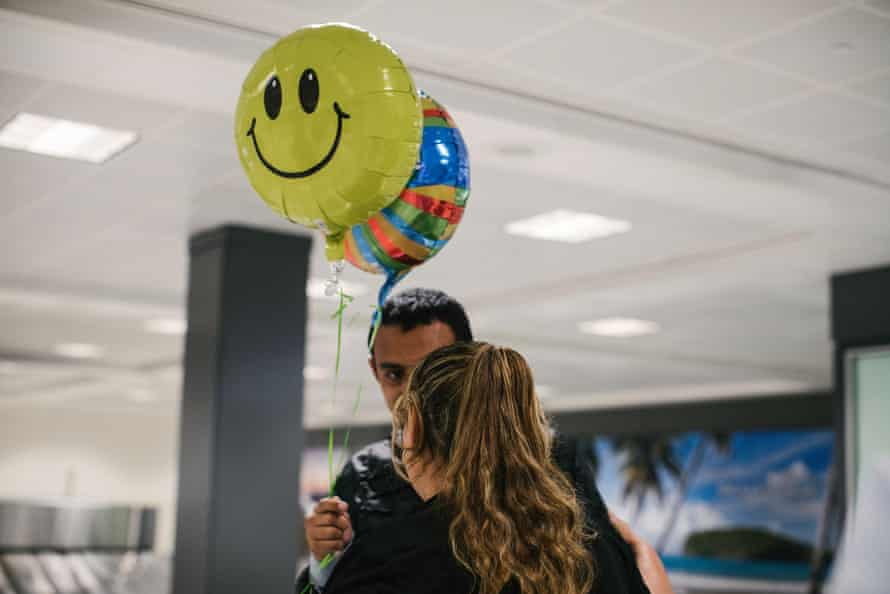 Marta greats her son Jose at baggage claim , inside of Dulles international airport, after he arrived from Dallas. This is the first time in 11 years that Marta has seen her son since she left El Salvador.