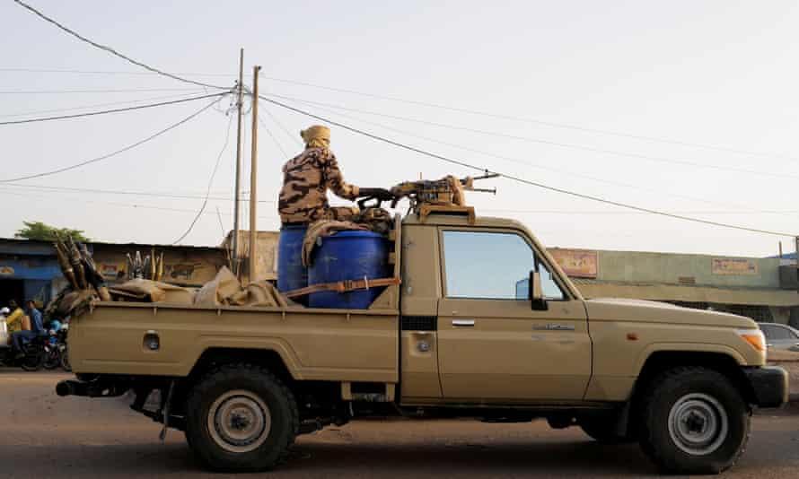 Members of Chad's security forces patrol N'Djamena.