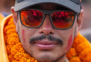The mountaineer Nirmal Purja arrives at Kathmandu airport in Nepal after climbing all 14 of the world's 8,000 metre-high mountains in less than seven months