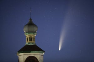 Neowise crosses the sky behind an Orthodox church in Turets, Belarus