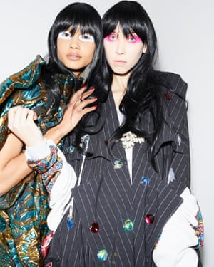 Two models wear Matty Bovan designs at London Fashion Week autumn/winter 2020 catwalk collections.