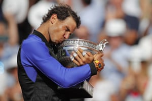 Rafael Nadal kisses the trophy as he celebrates winning his tenth French Open title.