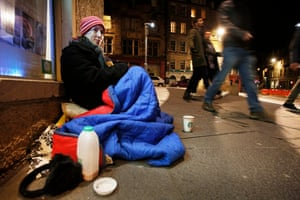 Miranda Tizard sits after midnight trying to beg up to the sum of £18 which will buy her a bed in a B&B in Leith