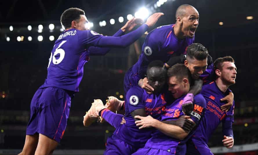 Liverpool celebrate after James Milner's opening goal.