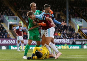 Burnley's James Tarkowski, Matthew Lowton and Joe Hart react after Chelsea's Alvaro Morata goes down at Turf Moor. Chelsea win 4-0 and continue unbeaten in the league.