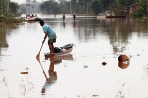 Xepian-Xe Nam Noy, Laos. A man traverses floodwater after the deadly collapse of a hydroelectric dam in Attapeu province.