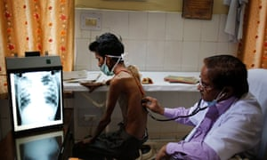 A doctor examines a tuberculosis patient in a government TB hospital in Allahabad, India.