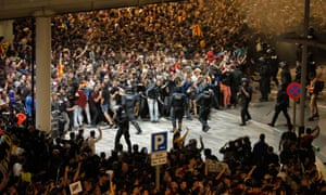 Protesters clash with police outside El Prat airport