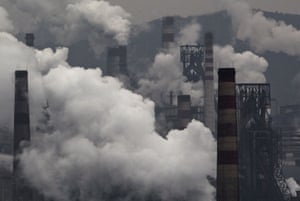 Smoke billows from a coal-fired power station at a steel factory in Hebei, China.