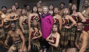 Hillary Clinton poses with the Maori performing arts group Te Kapa Haka o Whāngārā Mai Tawhiti in Auckland, New Zealand