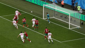 Morocco's Aziz Bouhaddouz heads in to his own goal.