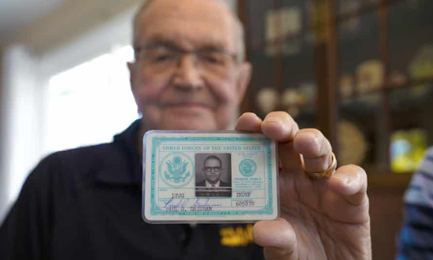 Paul Grisham holds his Navy ID card.
