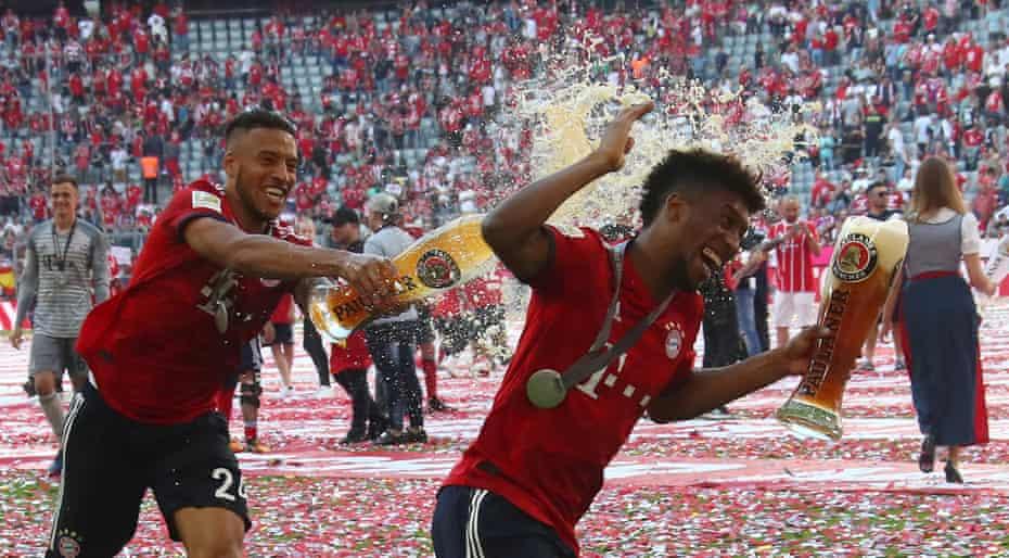 Bayern Munich's Corentin Tolisso and Kingsley Coman celebrate winning the Bundesliga.