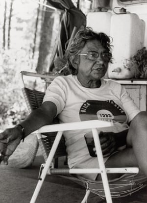 Woman in a T-shirt sitting in a collapsible chair