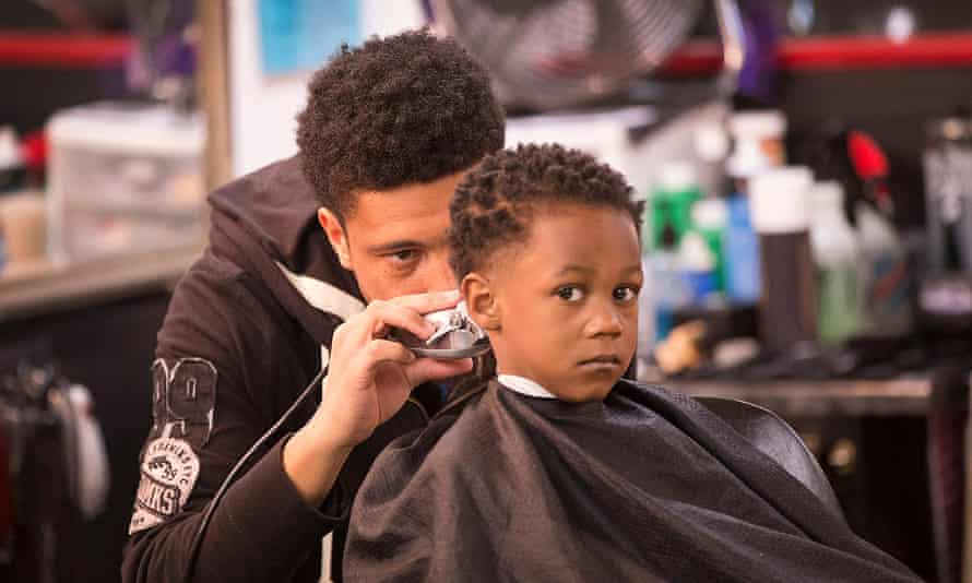 Branden Turner cuts Deverain Word's hair at the Prime Time barbershop in Ferguson, Mo. Turner and other barbers around the US are in prime positions to help educate local communities on elections and sociopolitical issues.