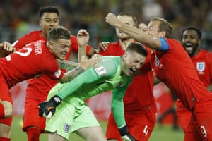 Jordan Pickford is swamped by team-mates after his heroic save from Colombia's Carlos Bacca.