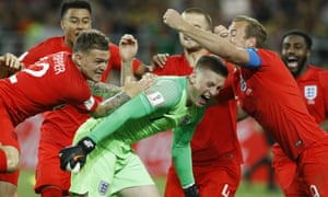 Jordan Pickford and team-mates celebrate after penalty shootout victory in Moscow.