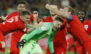 England's Harry Kane, right, goalkeeper Jordan Pickford, centre, and Kieran Trippier celebrate with teammates at the end of the round of 16 match between Colombia and England.