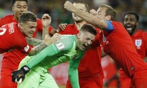 England's Harry Kane, right, goalkeeper Jordan Pickford, centre, and Kieran Trippier celebrate with teammates after winning the round of 16 match against Colombia.