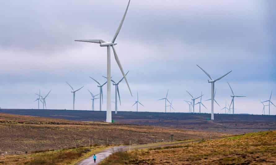 Scottish Power's wind turbines in East Renfrewshire, Scotland. The company sold off all its fossil fuel projects in 2018.