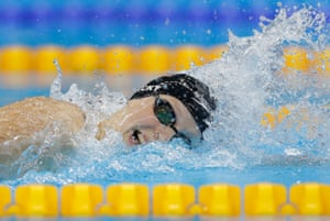 Pretty flipping fast: Katie Ledecky celebrates her gold medal in the women's 400m freestyle and a new world record.