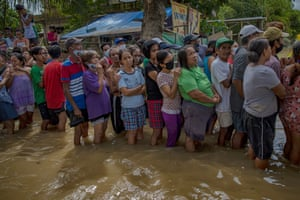 Tuguegarao, Philippines. Residents affected by Typhoon Vamco queue in flood waters to receive relief goods in Cagayan province. The Cagayan Valley in the north of the country has been hit by its worst flooding in 48 years after a dam released massive amounts of rainwater when the typhoon struck. The country continues to reel from the widespread destruction caused by this year's deadliest storm, which has killed at least 67 people