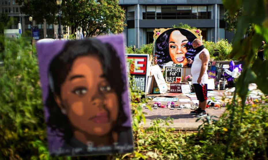 A man pauses at the memorial of Breonna Taylor in Louisville, Kentucky.