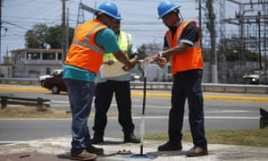 Puerto Rico Water Authority workers close a valve that supplies most of the metropolitan area with water in Carolina, Puerto Rico.