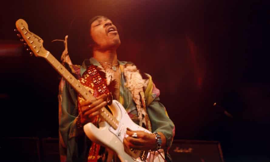 Jimi Hendrix plays a white Fender Stratocaster.