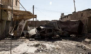 Burnt-out cars used as a temporary road blockade near a Syrian Democratic Forces base near the frontline.