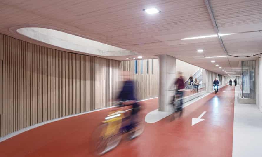 People cycle through Utrecht's multi-storey bike park
