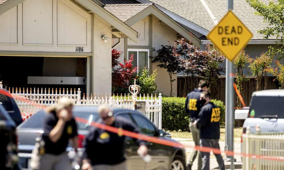 Authorities approach a home being investigated in connection to the shooting.