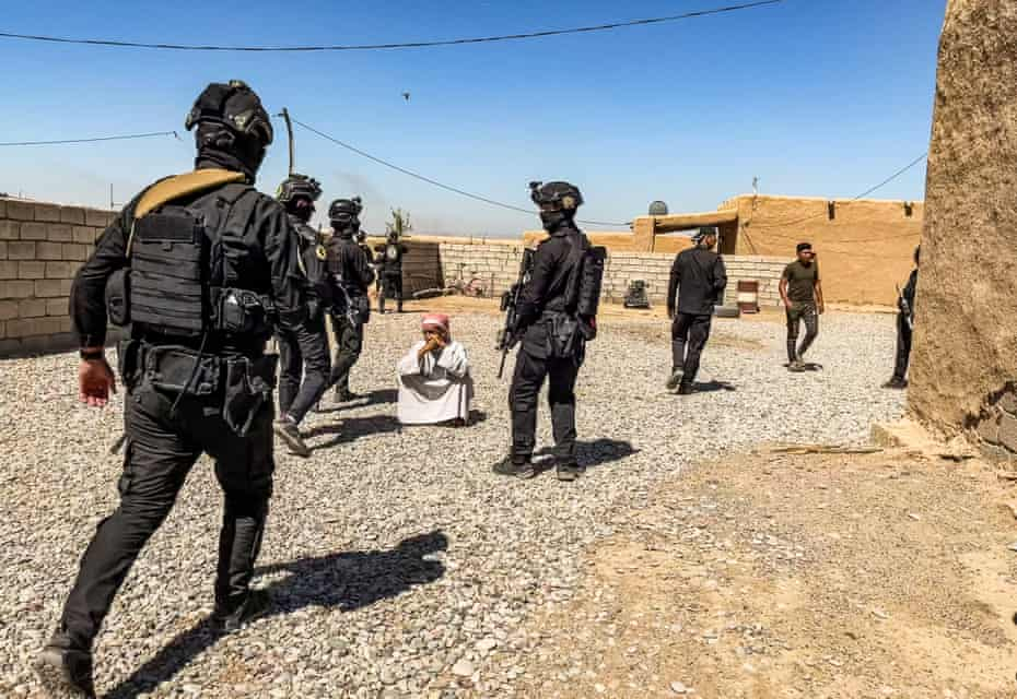 Troops round up villagers during search operations.