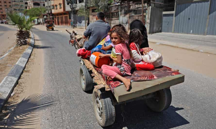 A Palestinian family on a carriage pulled by a donkey in Beit Lahia in the northern Gaza Strip, fleeing to safety last Friday.
