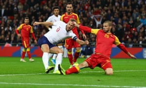 Harry Kane of England scores a goal to make the score 5-0 to complete his hat-trick.