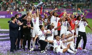 Lyon lift the trophy.