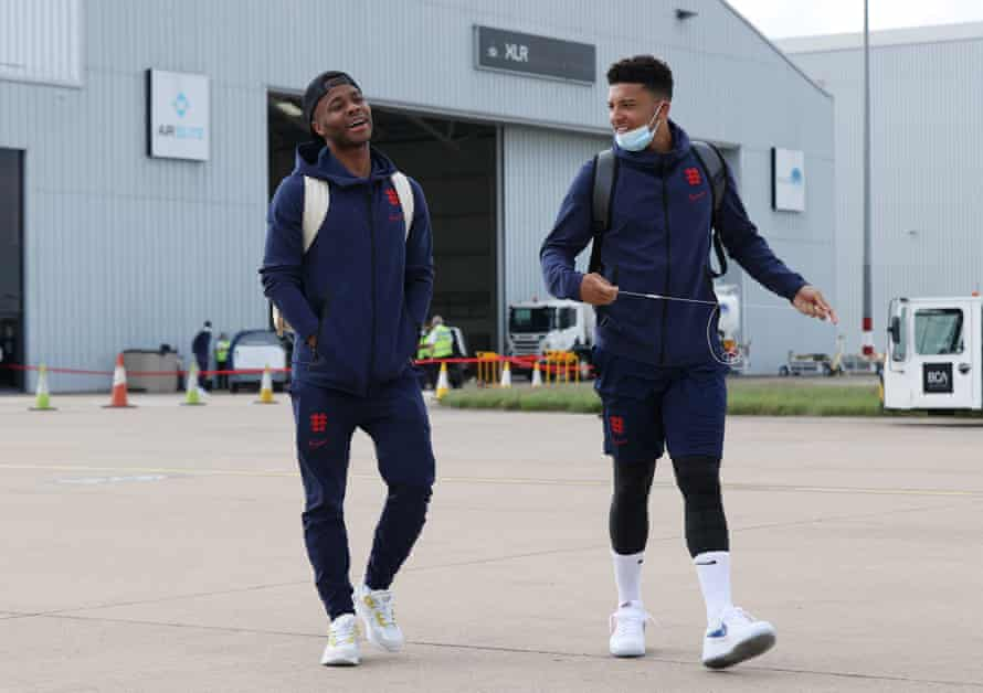 Raheem Sterling and Jadon Sancho board England's plane to Rome.