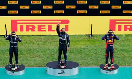 Lewis Hamilton performs a black power salute on the podium after winning the Styrian GP, with Valtteri Bottas and Max Verstappen second and third.