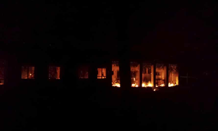 Fire is seen inside a Medecins Sans Frontieres (MSF) hospital building after an air strike in the city of Kunduz