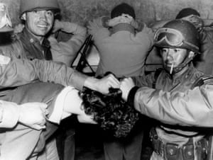 Soldiers cut a student's hair after he was arrested during the shooting at Tlatelolco.