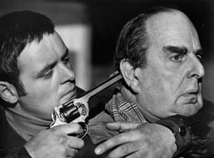 Anthony Hopkins grabs Robert Morley in a scene for the movie When Eight Bells Toll, 1971.