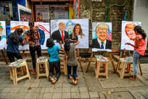 Mumbai, India. Students make paintings of Donald and Melania Trump in the run-up to a presidential visit. The city has been criticised for erecting a wall to hide slums along the Ahmedabad motorcade route