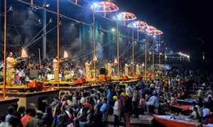 Participants performing with fire at Ganga river bank during the Ganga Arati Ceremony as part of the Diwal festival in 2019.