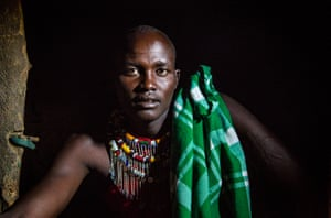Photographer Richard Moore: After travelling through Kenya photographing the Somali community, I visited a Maasai village on the border with Tanzania. This portrait shows Joseph, a Maasai warrior, sitting in his mother's home.