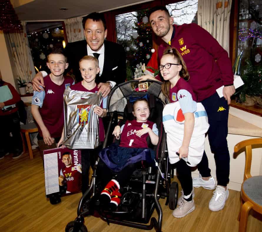 Aston Villa's John McGinn (right) and assistant coach John Terry visit Acorns Hospice in December last year.