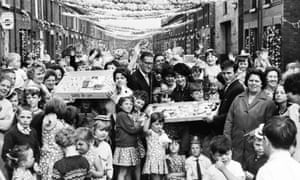Here, residents of Leta Street, near the Goodison Park ground where some of the matches were played, celebrate with cakes and party hats.